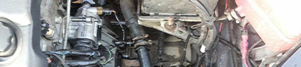 Термостат под капотом на Лада Калина 8 клапанов двигатель