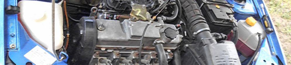 Двигатель 8 клапанов под капотом чистенько Лада Калина